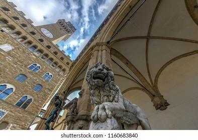 Firenze, Italy - March 21, 2018 : Statue in Loggia dei Lanzi (Perseus with the Head of Medusa) and lion in Florence, Italy.