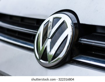 Firenze, Italy - September 28th 2015: Volkswagen plate logo on a modern car. Volkswagen is a famous European car manufacturer company based on Germany. Lens vignetting effect.