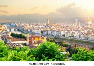 Firenze landmarks. Summer dawn in Florence. Cityscape skyline of Florence Italy with Duomo, Square of Signoria, Palazzo Vecchio, Basilica di Santa Maria del Fiore and the bridges over the river Arno.