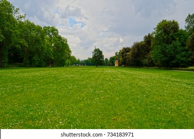 Firenze, Le Cascine park. A wide green meadow surrounded by trees