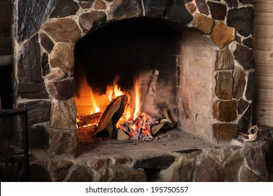 Fireplace. Burning firewood in the hearth.