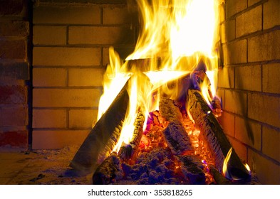 Fireplace with burning logs.