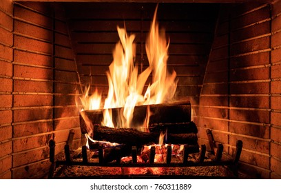 Fireplace burning wood logs, cozy warm home christmas time