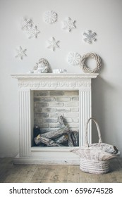 Fireplace with christmas decorations in comfortable living room