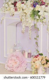 Fireplace decorated with flowers.