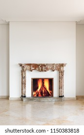 Fireplace detail with lit fire. concept
