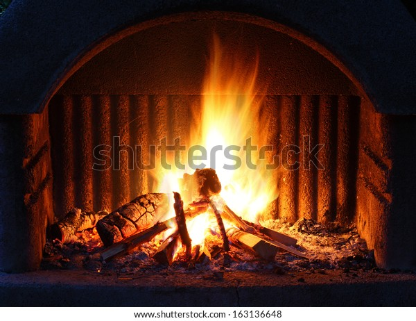 Fireplace with fire at night - outdoor shot