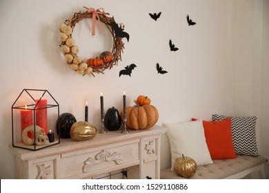 Fireplace and Halloween decor in room. Idea for festive interior