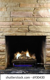 Fireplace with modern stone and gas logs