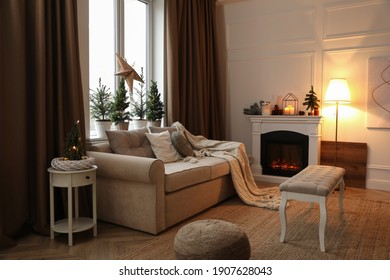 Fireplace in room with Christmas decorations. Interior design