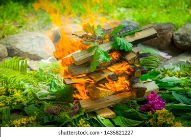 Fireplace from stones, bonfire from firewood and flowers