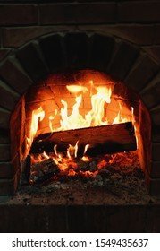 fireplace in which the fire burns