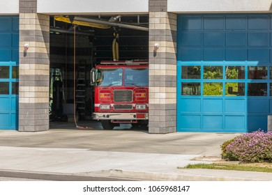 Firestation House with firetruck showing in open bay door