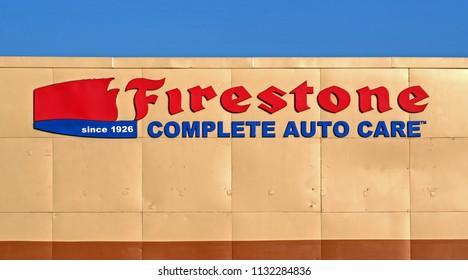Firestone auto care service center building signage, Revere Massachusetts USA, July 8, 2018