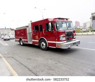 A Firetruck speeding down a street to a call.