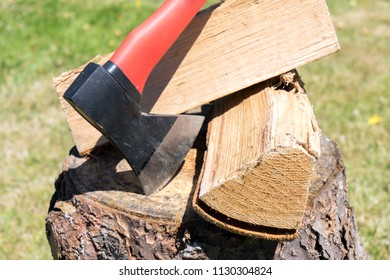 Firewood and an ax in a garden