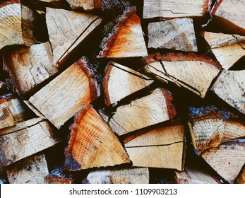 Firewood background, wall firewood, background of dry chopped firewood logs in a pile
