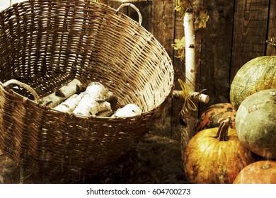 Firewood basket and pumpkins