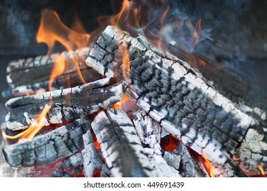 Firewood burning on a grill