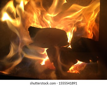 firewood is burning in the stove