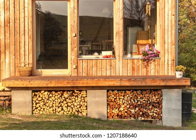 Firewood for ecological house. Fuel preparation for winter. Stored fuel for the winter. Stock of wood