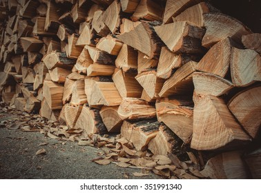 a lot of firewood outdoor, brown background