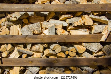 Firewood preparation for the fireplace. Firewood background. Stacks of firewood. Pile of firewood.