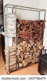 Firewood rack for wood, kindling and newspaper, next to pot belly fire
