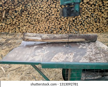Firewood ready to cut with bandsaw.