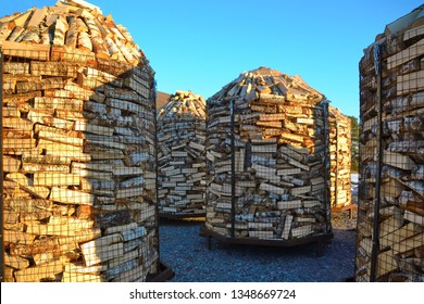 Firewood for sale in big round metal cages. Wood is considered humankind's very first source of energy. Today it's the most important single source of renewable energy, thus not environmental friendly