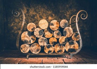 Firewood stack in dark at home for fireplace - retro style