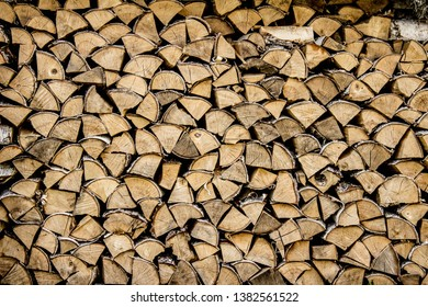 Firewood stacked. Background. Texture. Wooden background. Firewood is laid in a pattern.