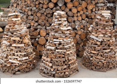 Firewood is stacked in pyramids. Wood fuel. Wooden logs were beautifully folded in pyramids.