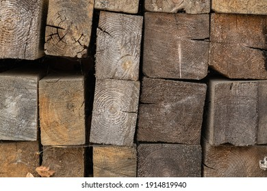 firewood stacked in a woodpile. Aged timber. Pattern