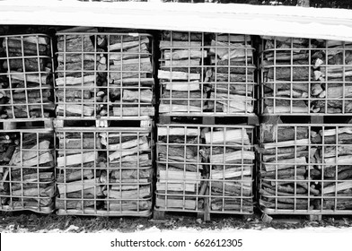 firewood stored in Grid boxes in black and white