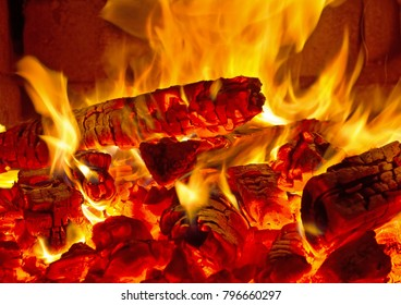firewood,burning, fire,embers, in the stove,the concept of wood heating,