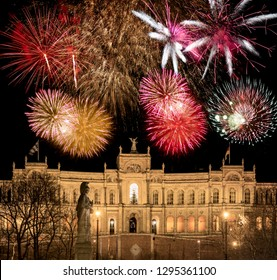 Firework above the Maximilianeum, which is  housing the bavarian parliament in Munich.