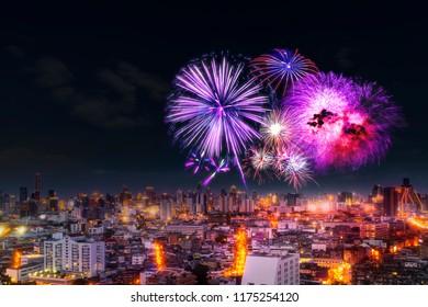 firework celebration in Bangkok city skyline with  Twilight night and firework lighting in bangkok cityscape background, Thailand.