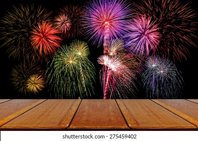 Firework celebration on dark background with Wood Table.