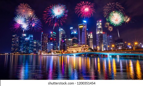 Firework with cityscape night light view of river side Singapore skyline at twilight time