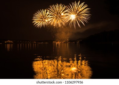 Firework competition at Brno dam with reflection in water, Czech republic, South Moravia, Europe