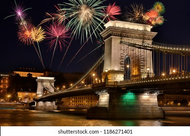 Firework display and the Szechenyi Chain Bridge over the River Danube in the city of Budapest, Hungary.