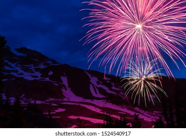 Firework display at the top of Whistler Mountain on Canada Day in the summer time