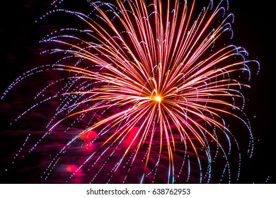 Firework fireworks celebration blue spikes red purple yellow