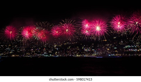Firework on the beach. Bay filled with light and firework