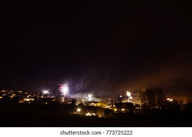 Firework over the small city suburb .