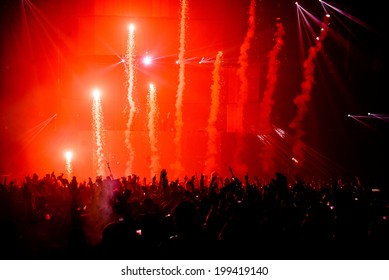 Firework pyro at music festival concert with crowd silhouette