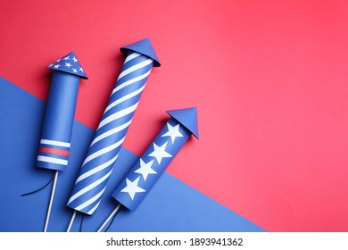 Firework rockets on color background, flat lay. Space for text