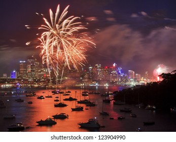 firework in Sydney new year eve event celebration bright pyrotechnic lights reflect in harbor water over city CBD