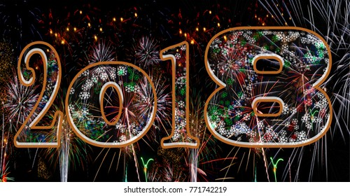 Fireworks 2018 New Years Eve concept holiday background large numbers exploding bursting fire works in the night sky with snowflakes
